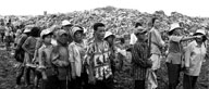 Cambodian people in front of rubbish tip.